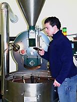 Master roaster Martin Jennings sampling coffee